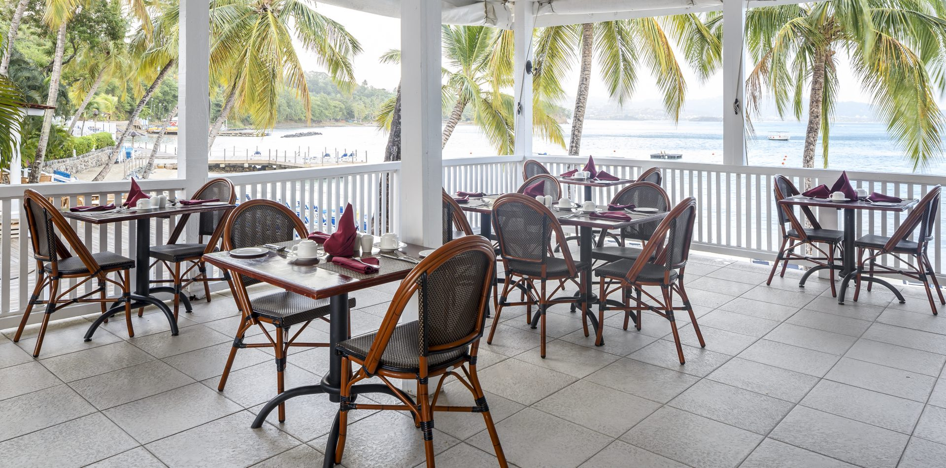 outdoor dinning on terrace at Windjammer Landing Villa Beach Resort