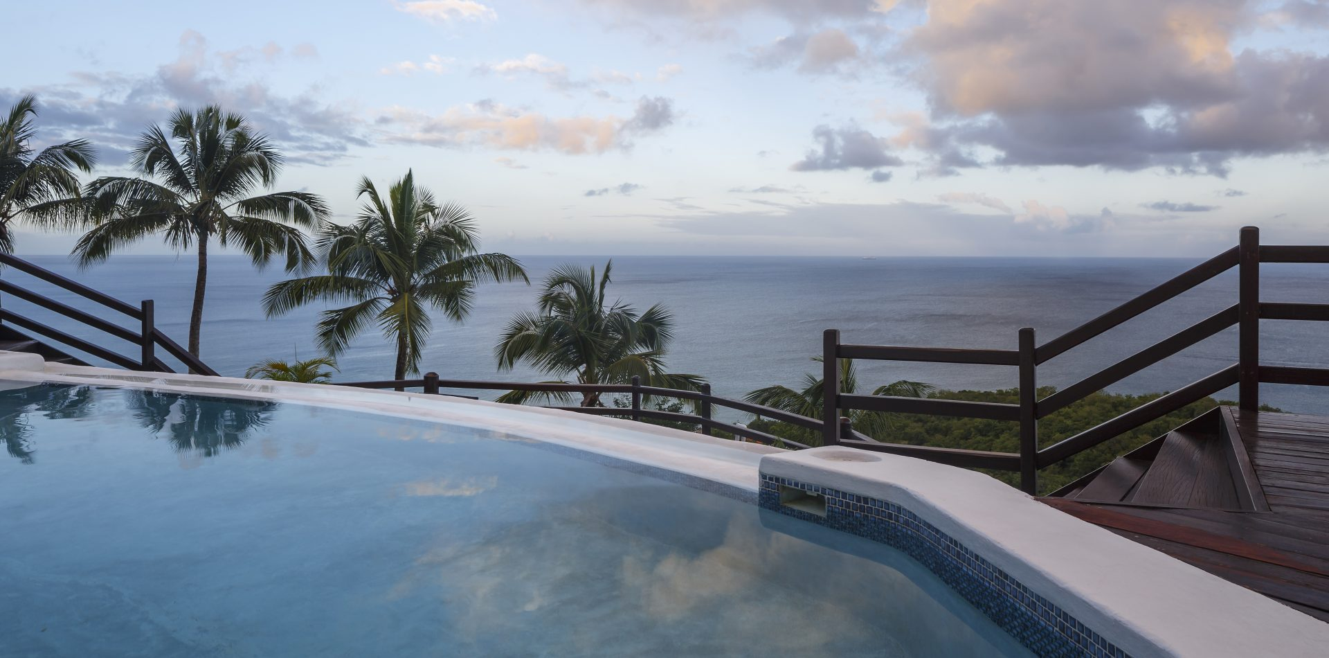 outdoor pool with ocean view at our St Lucia resort