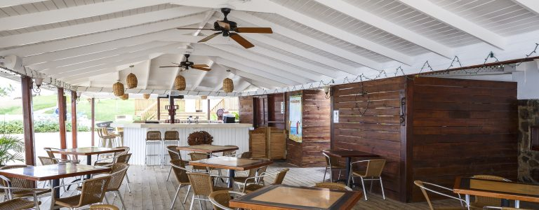 outdoor dining areas at Windjammer Landing Villa Beach Resort