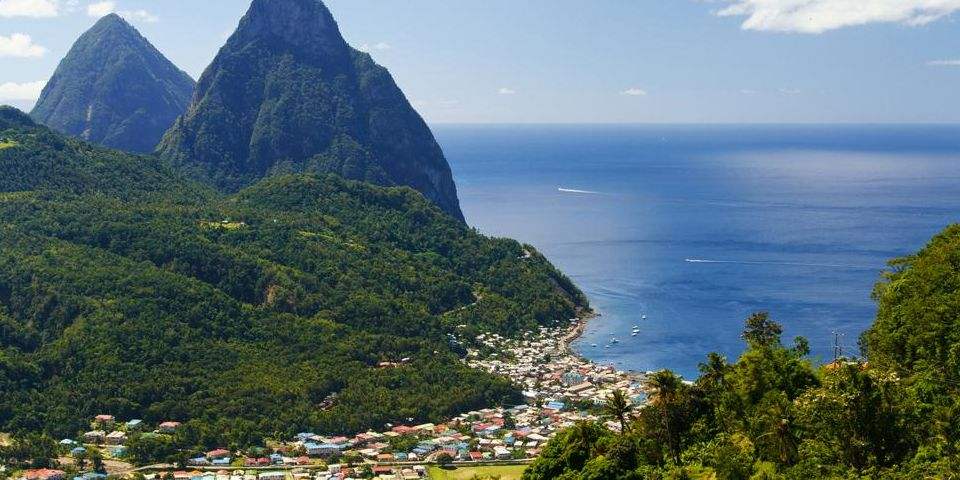 A Large Body Of Water With Pitons In The Background